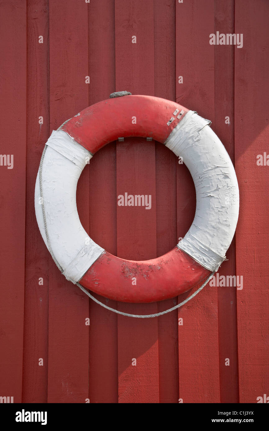 Life Ring Hanging on Wall, Vest-Agder, Southern Norway, Norway Stock Photo