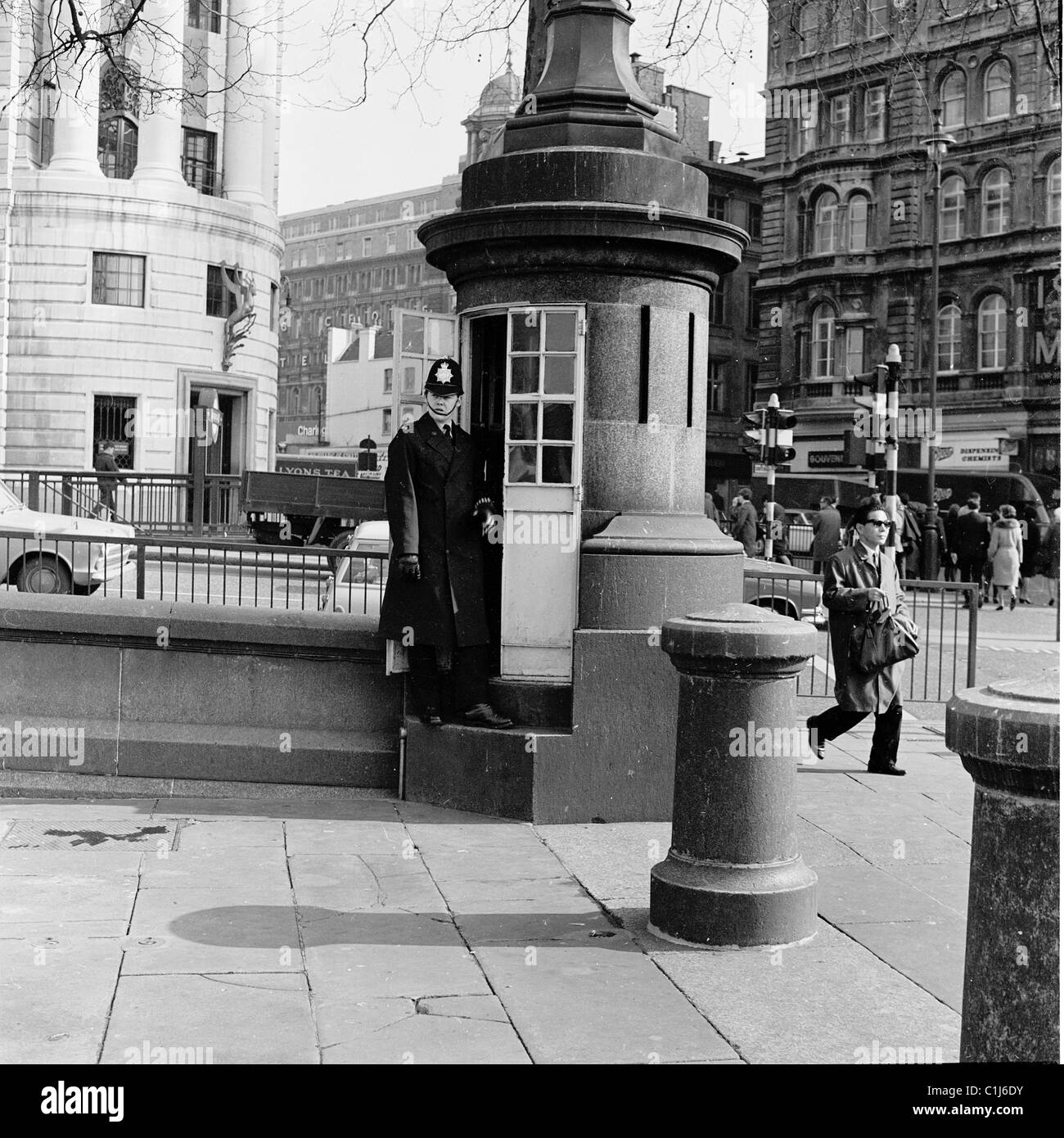 1950s, historical picture, a British policeman stands at the one-man police box at Trafalgar Square, London, Britain's - Stock Image