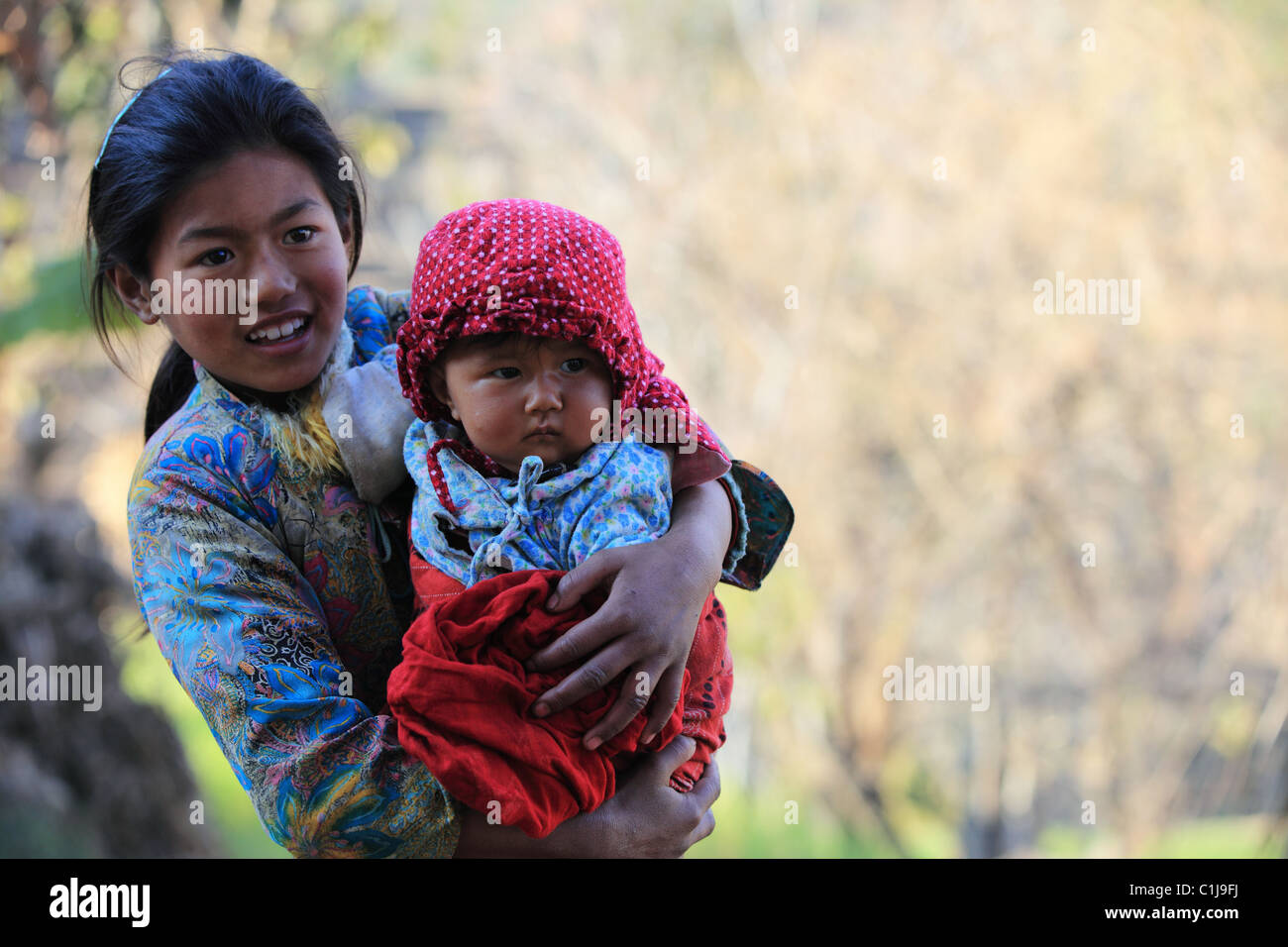 Nepal girl mother baby stock photos nepal girl mother baby stock nepali girl with child stock image ccuart Images