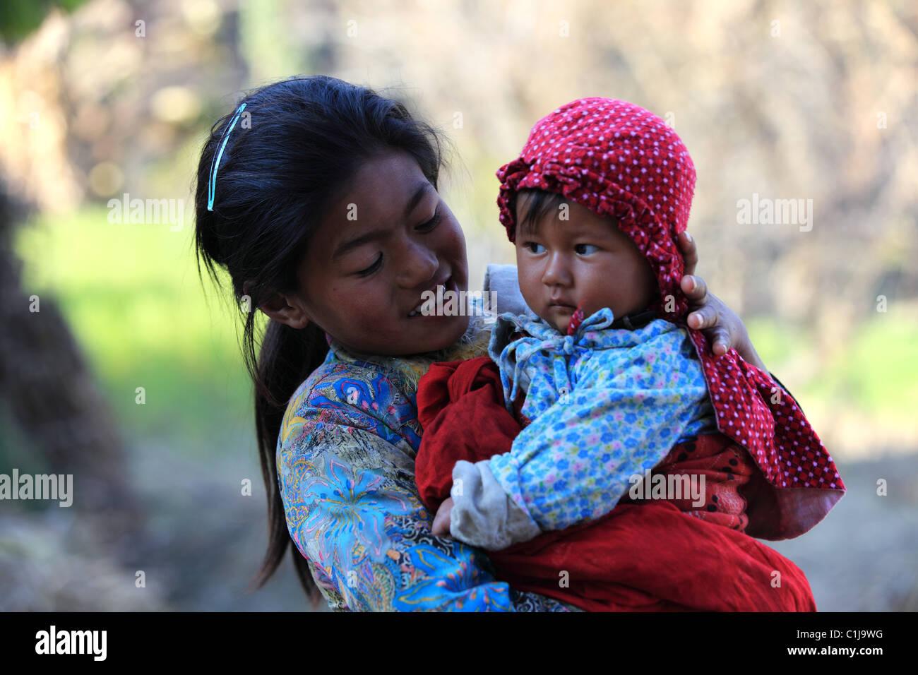 Nepal girl mother baby stock photos nepal girl mother baby stock nepali girl with child stock image ccuart Gallery