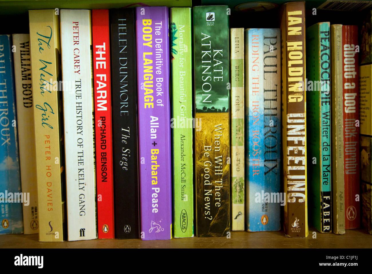 Novels paperback books bookshelf - Stock Image