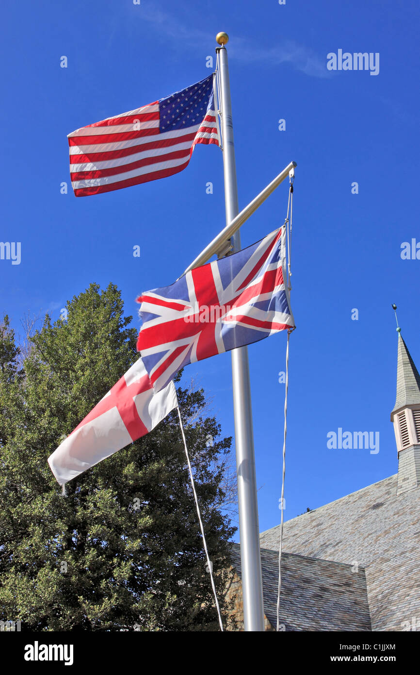 Flagpole in front of church, Long Island, NY - Stock Image