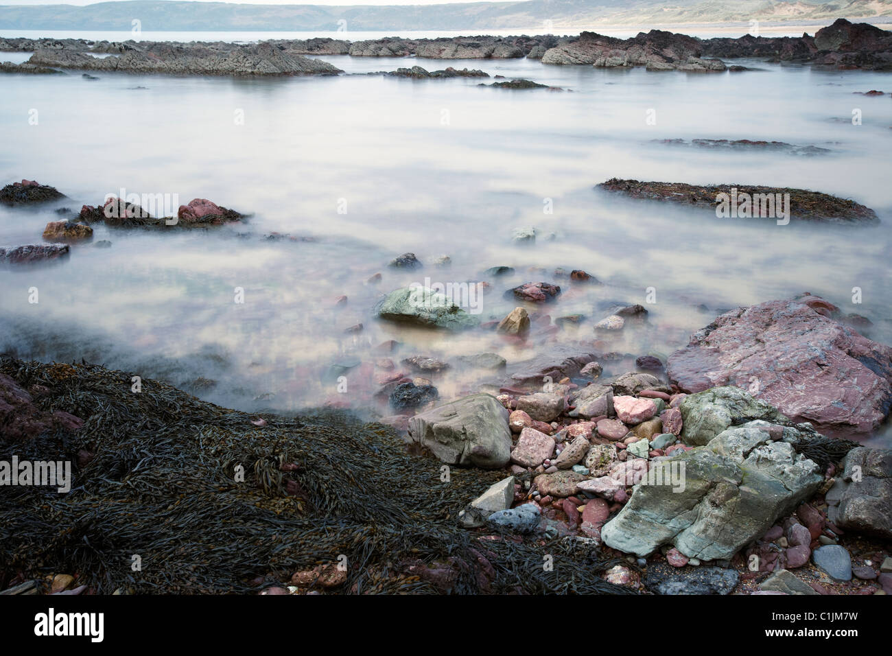 Rising tide, Freshwater West Bay, Pembrokeshire, Wales, UK Stock Photo