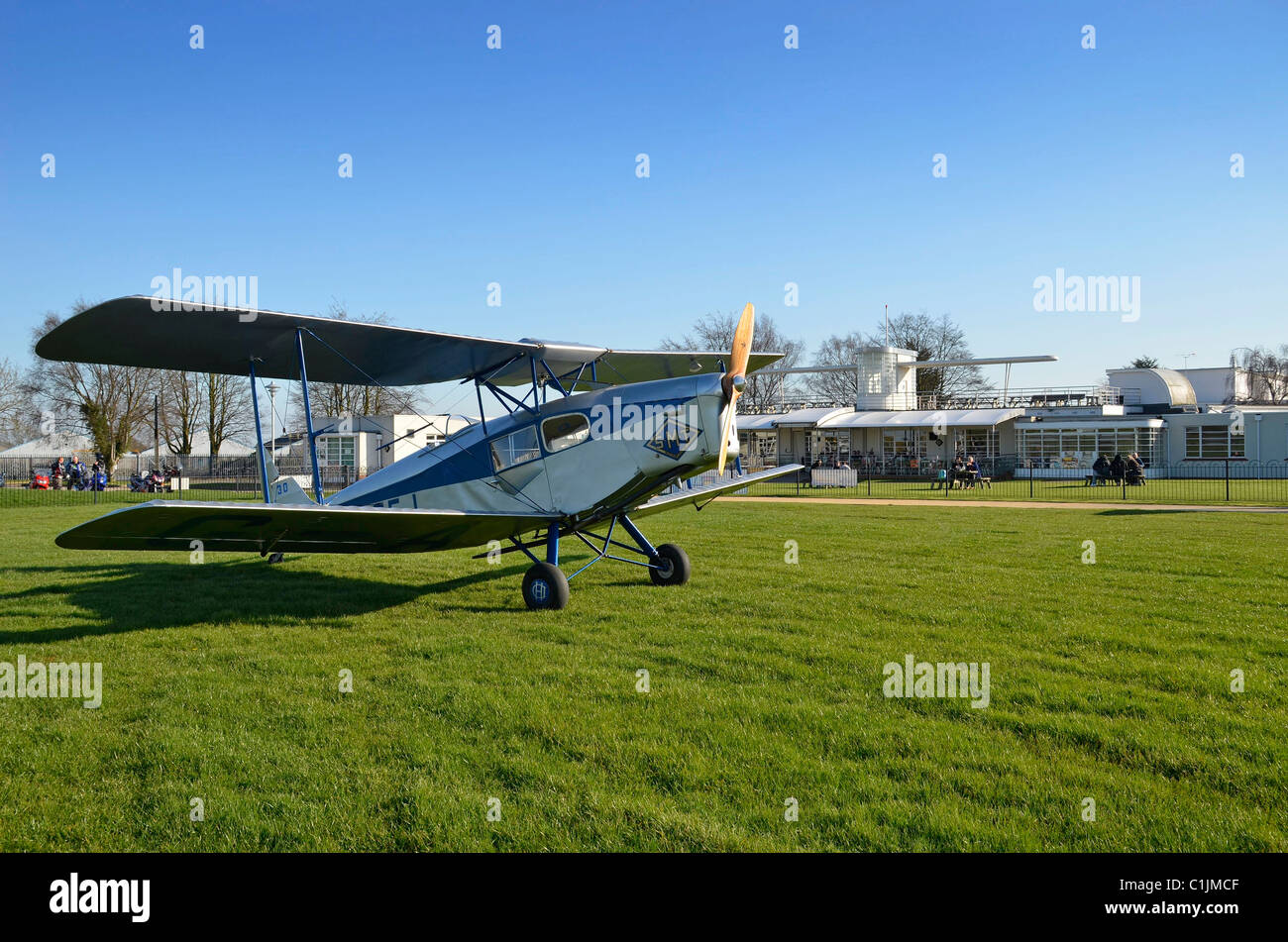 DH 83 fox moth outside sywell airfield art deco club house - Stock Image