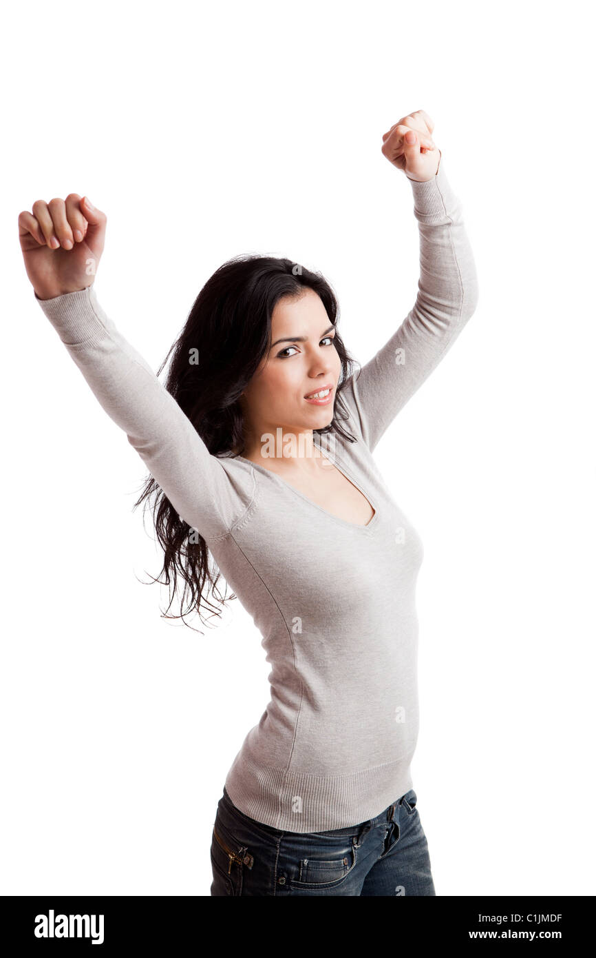 Happy young woman with arms up, isolated against a white background - Stock Image