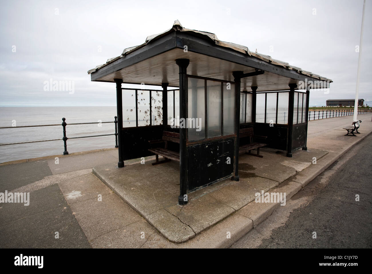 A seaside shelter on the promenade at Hoylake, Wirral, NW UK. This image looks out towards Hoyle Bank Stock Photo