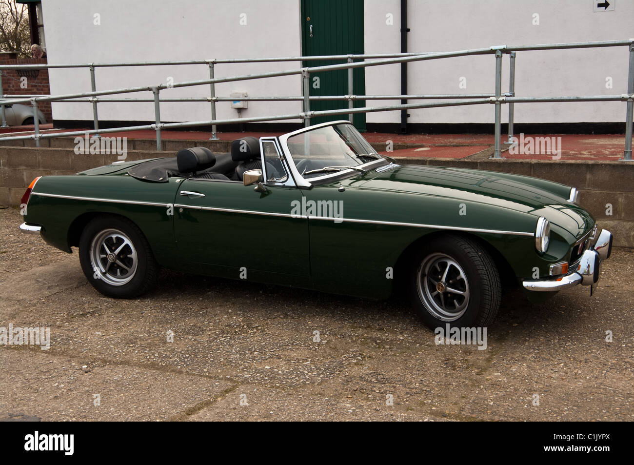 Green MGB soft top sports car, with top down - Stock Image