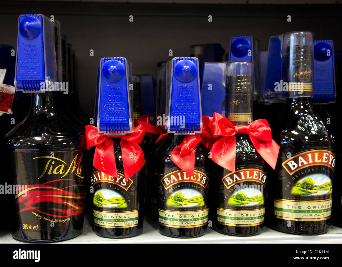 Bottles of Baileys liqueur security tagged in a UK supermarket Stock Photo