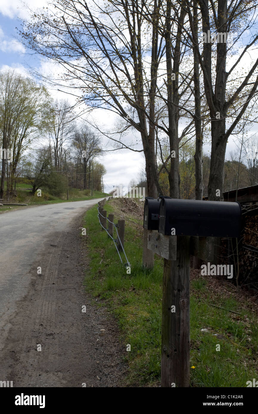 A double mailbox sits on a lonely rural road in western Massachusetts. - Stock Image