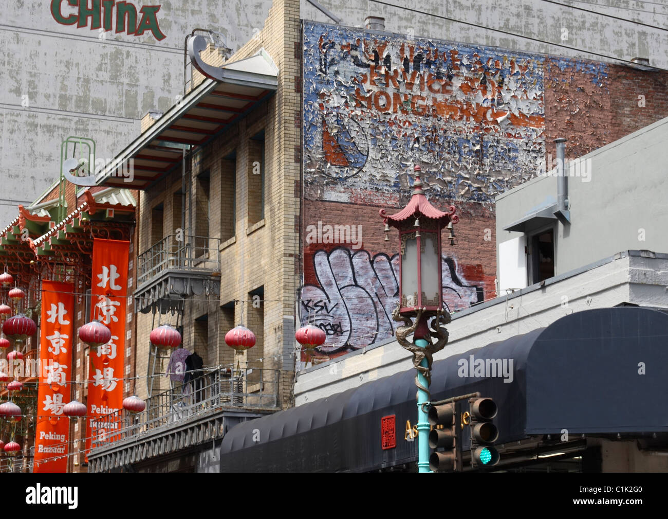 Taken in San Francisco's Chinatown, traditional Chinese lanterns and colourful hanging banners clash with modern - Stock Image