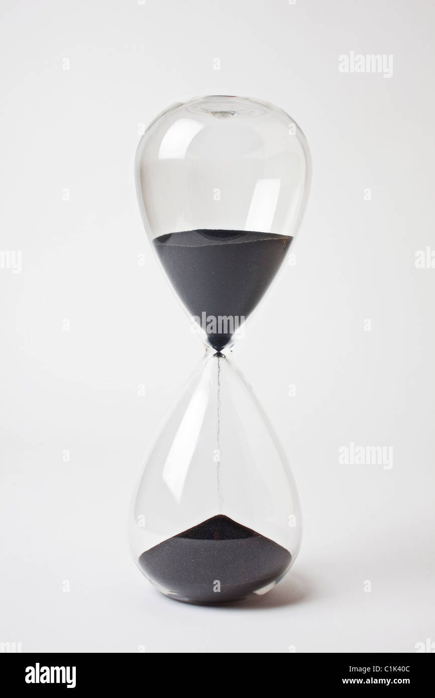 Hourglass black sand timer - Stock Image