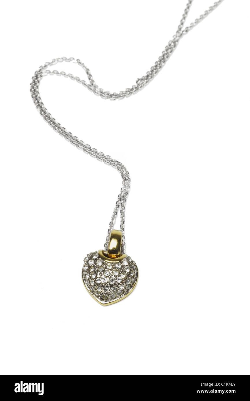 Heart shaped gemstone necklace on white background - Stock Image