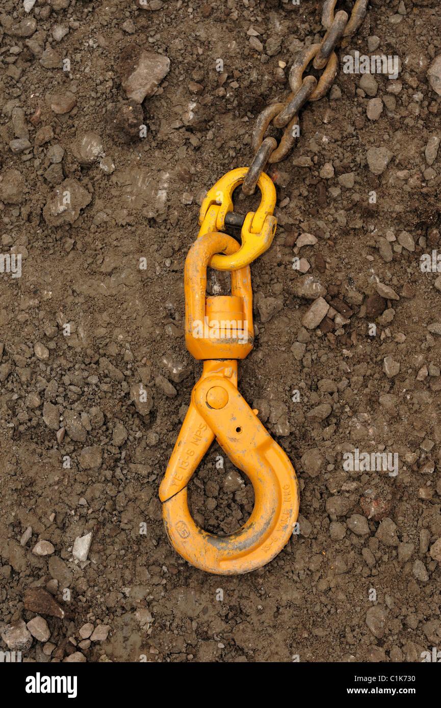 Heavy duty yellow crane hook - Stock Image