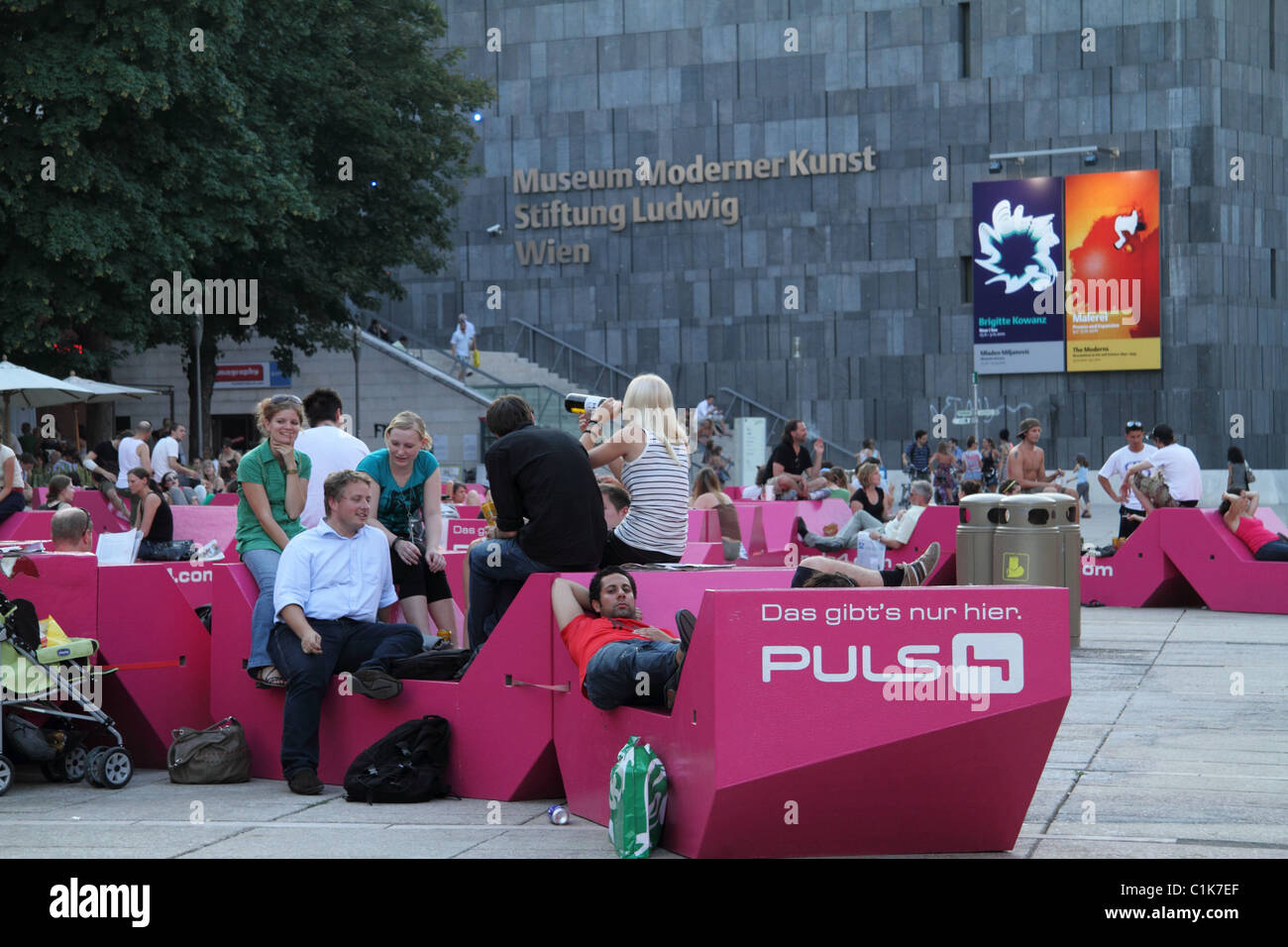 People relaxing outside Museum Moderner Kunst Stiftung Ludwig, Museums Quartier - Stock Image