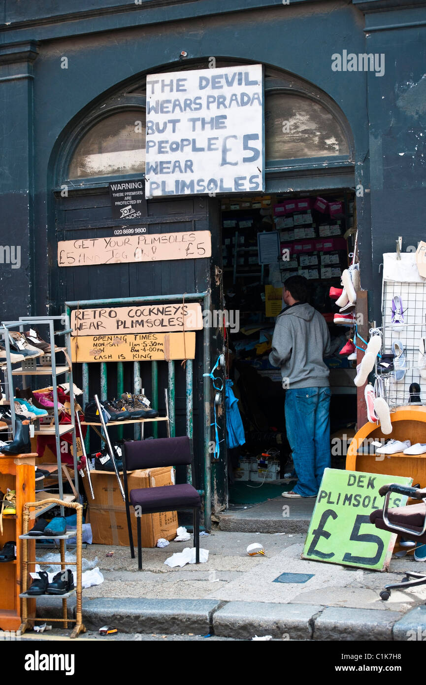 Shop specializing in Plimsole Shoes in Bethnal Green London - Stock Image