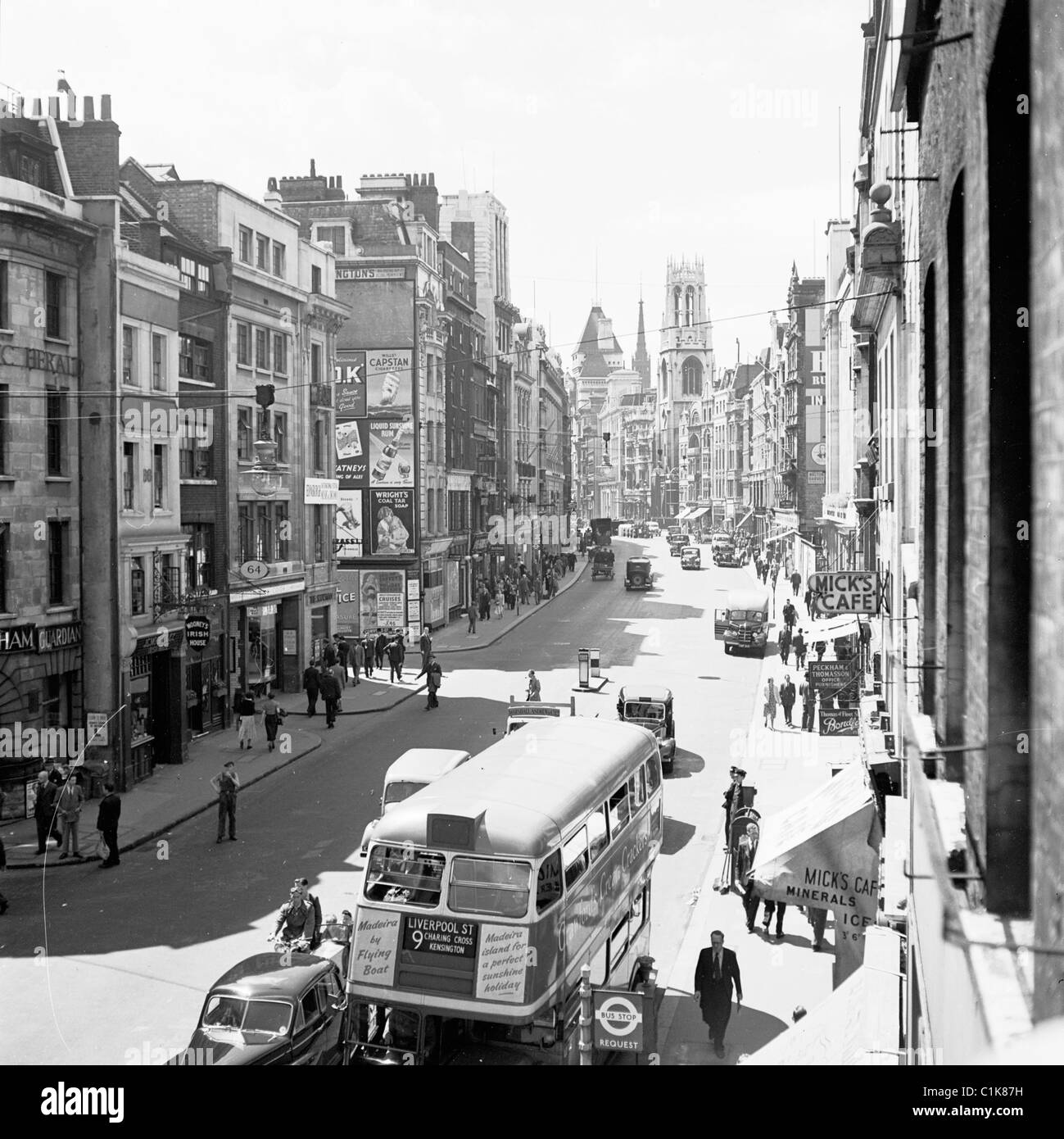 London, 1950s. A view along Fleet street, home  to the London newspapers, showing the Number 9 routemaster Bus. Stock Photo