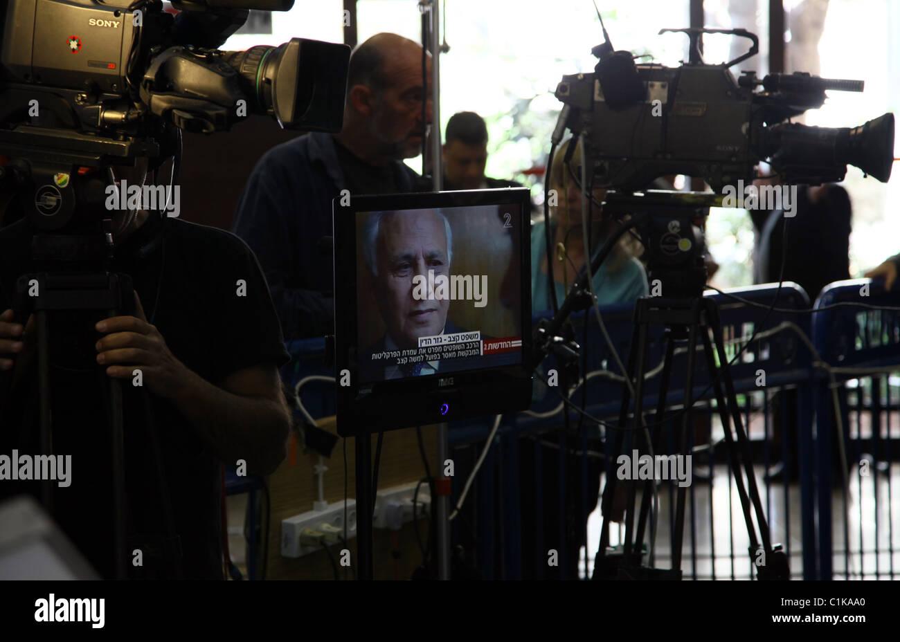 Former Israeli President Moshe Katsav is seen on a monitor as he arrives at a court in Tel Aviv Israel - Stock Image