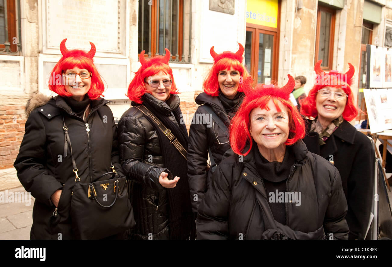 A group of middle aged women enjoying themselves at the Venice carnival, Venice Italy - Stock Image