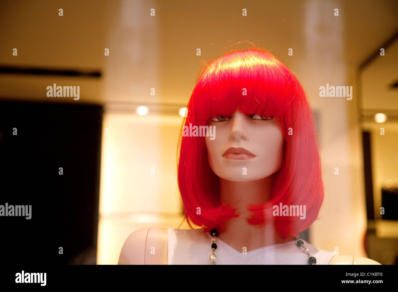 Redheaded tailors dummy in a shop window, Chanel, Venice, Italy Stock Photo