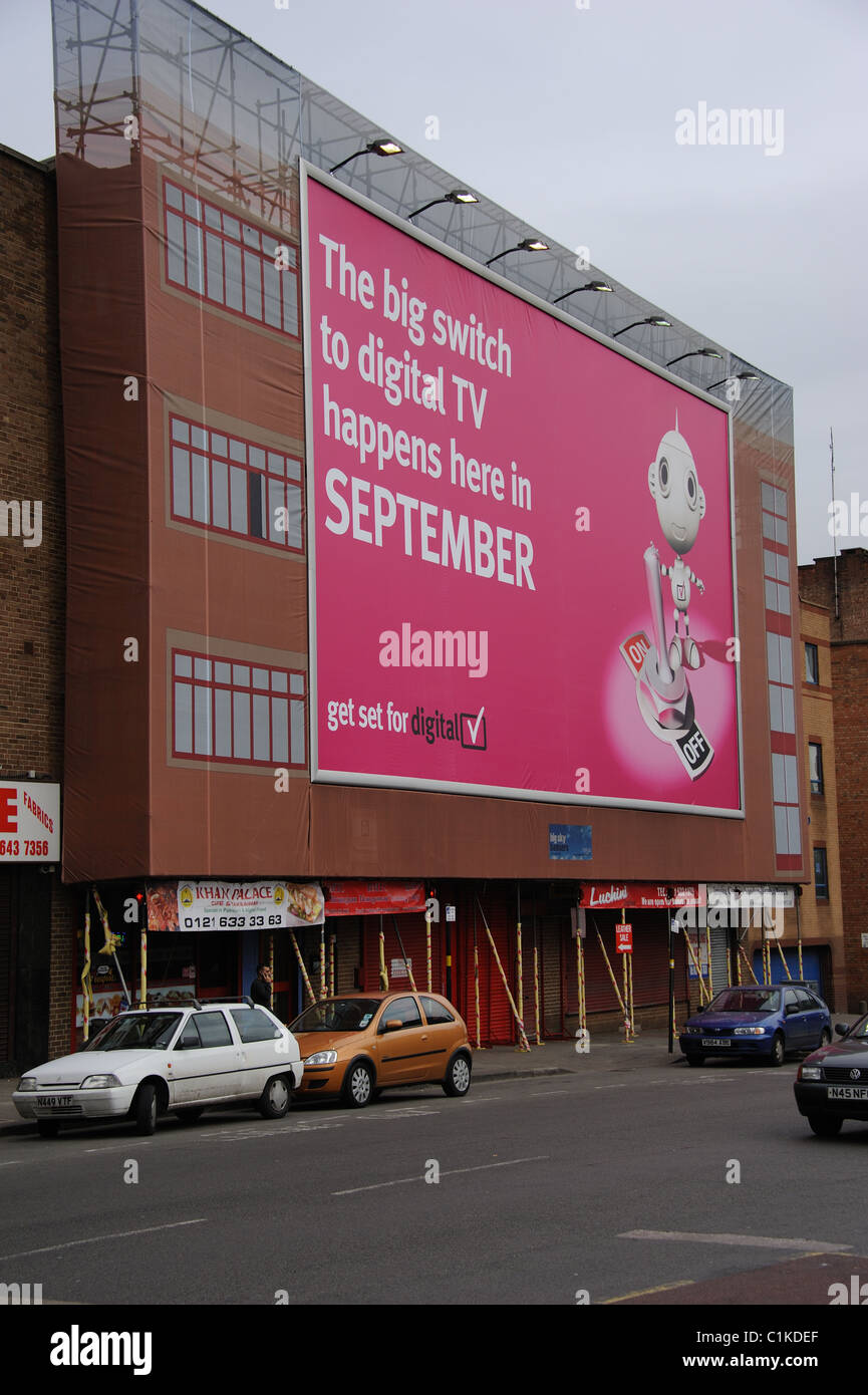 Switch to digital tv in September being advertised on a building in central Birmingham UK - Stock Image