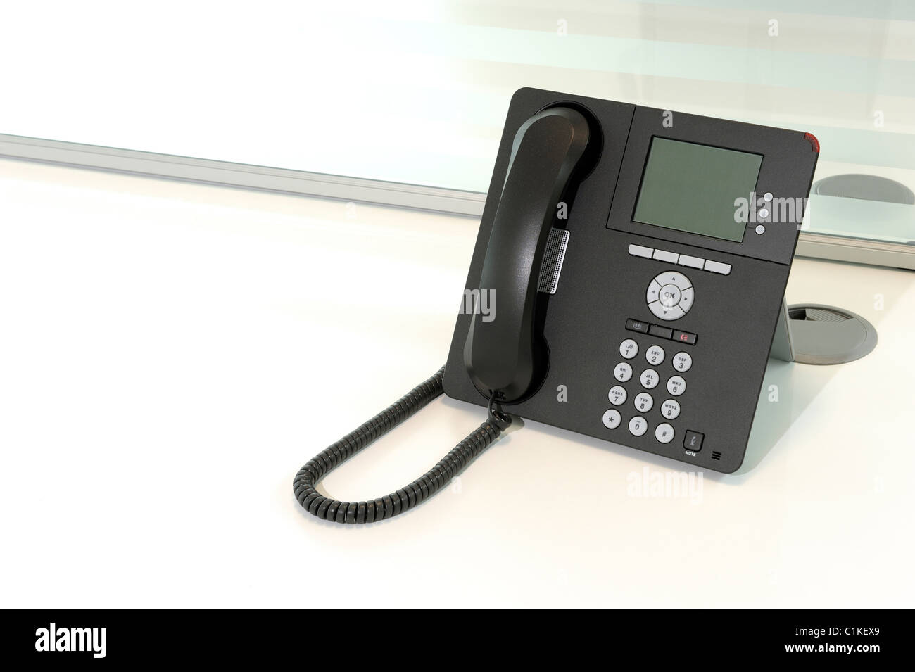 Office phone on a desk - Stock Image