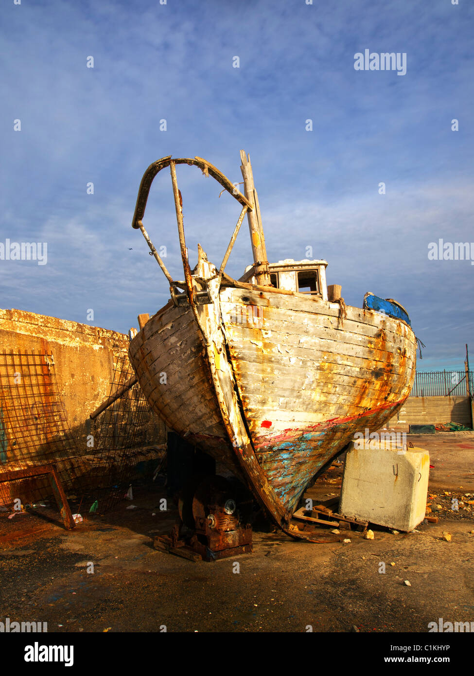 Israel, Tel Aviv-Jaffa, Old dilapidated boat at dry dock at the Jaffa port - Stock Image