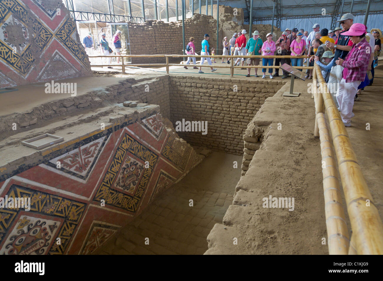 Tourists looking at Ancient paintings at the Huaca de la Luna, Trujillo, Peru - Stock Image