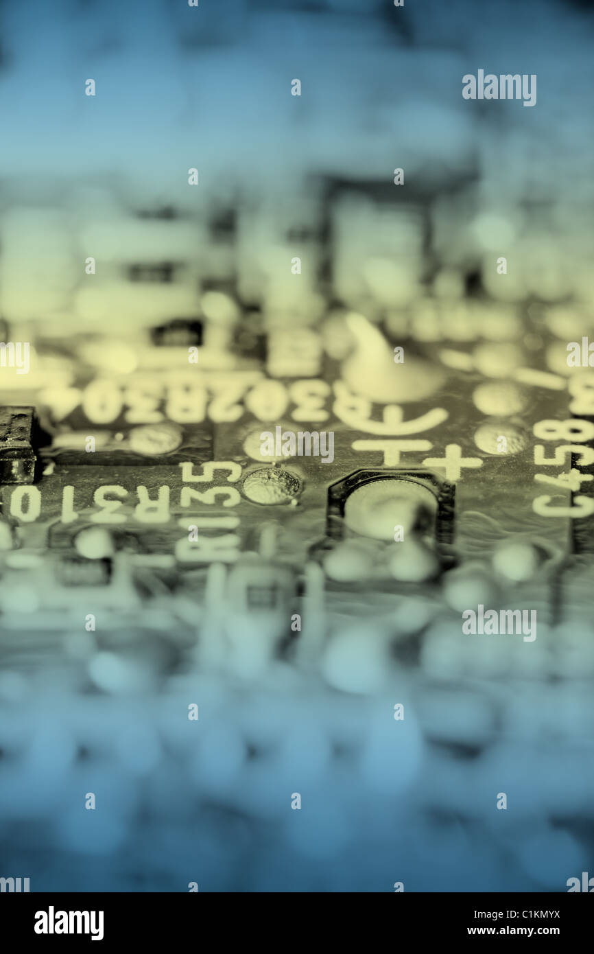 Close up of retro electronic circuit board, toned. - Stock Image