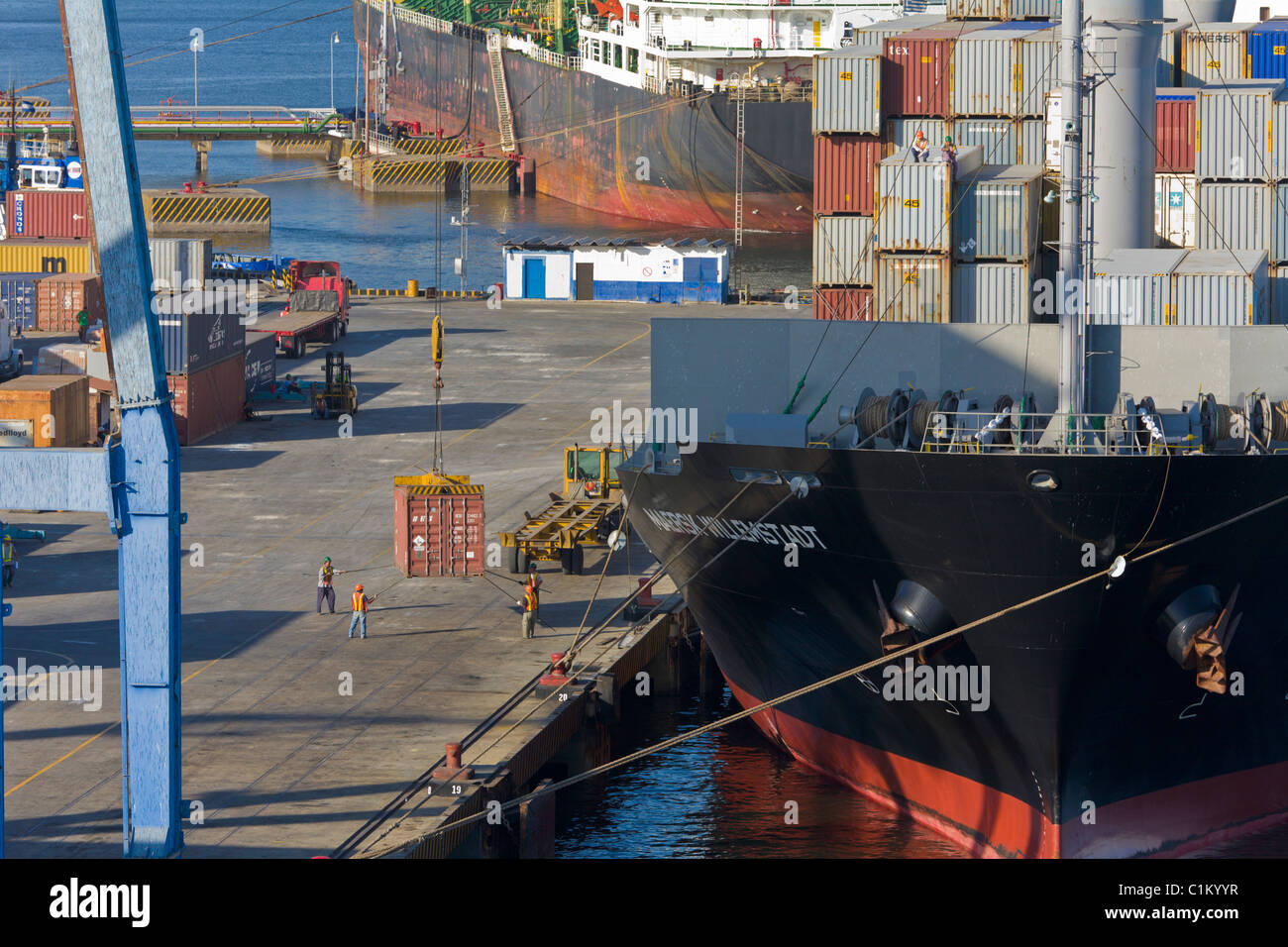 Container ship being unloaded, Port of Corinto, Nicaragua Stock Photo