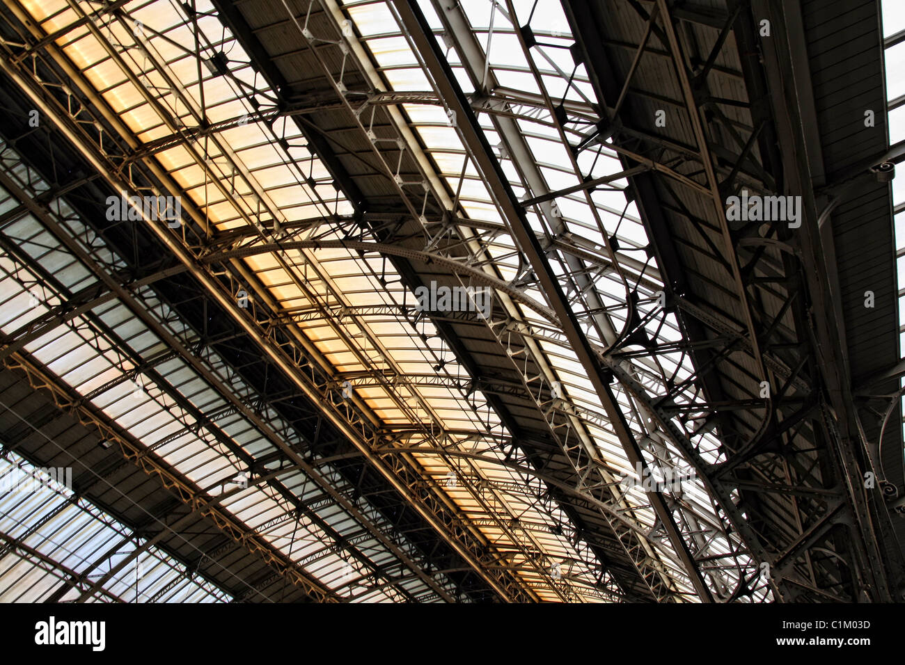 ceiling indoor railway station in Lvov.Roof detail , arch vault, rivet steel framework with windows. - Stock Image