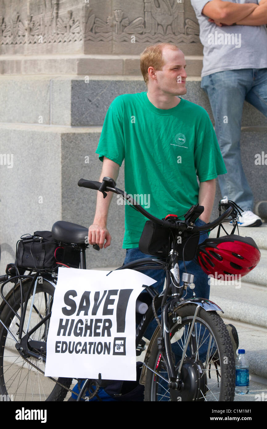 Demonstrator protesting educational funding cuts on the steps of the state capitol building in Baton Rouge, Louisiana, - Stock Image