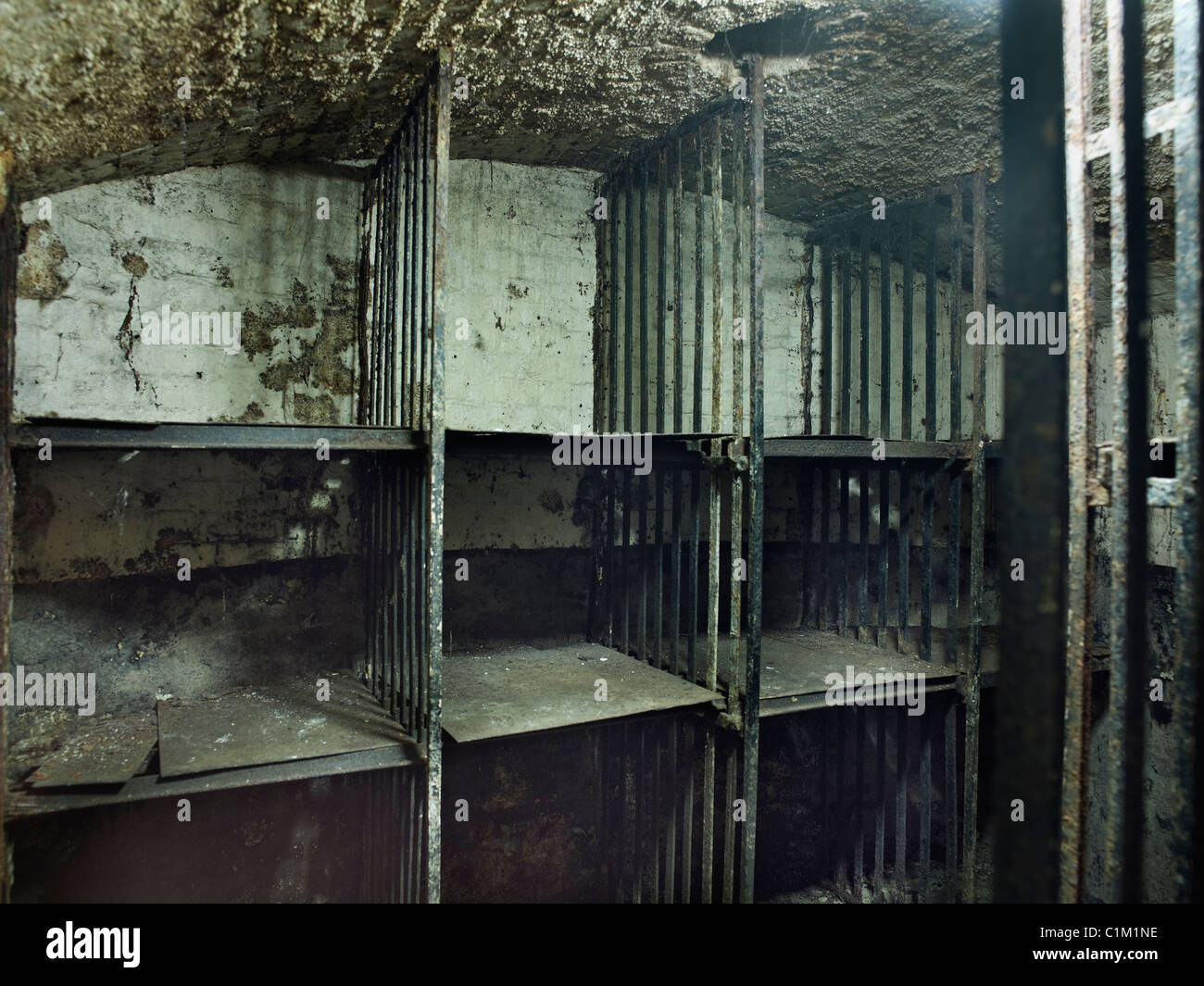 Newgate cells in Viaduct Tavern, City of London. cells were once part of Giltspur Comptor, with metal cages - Stock Image