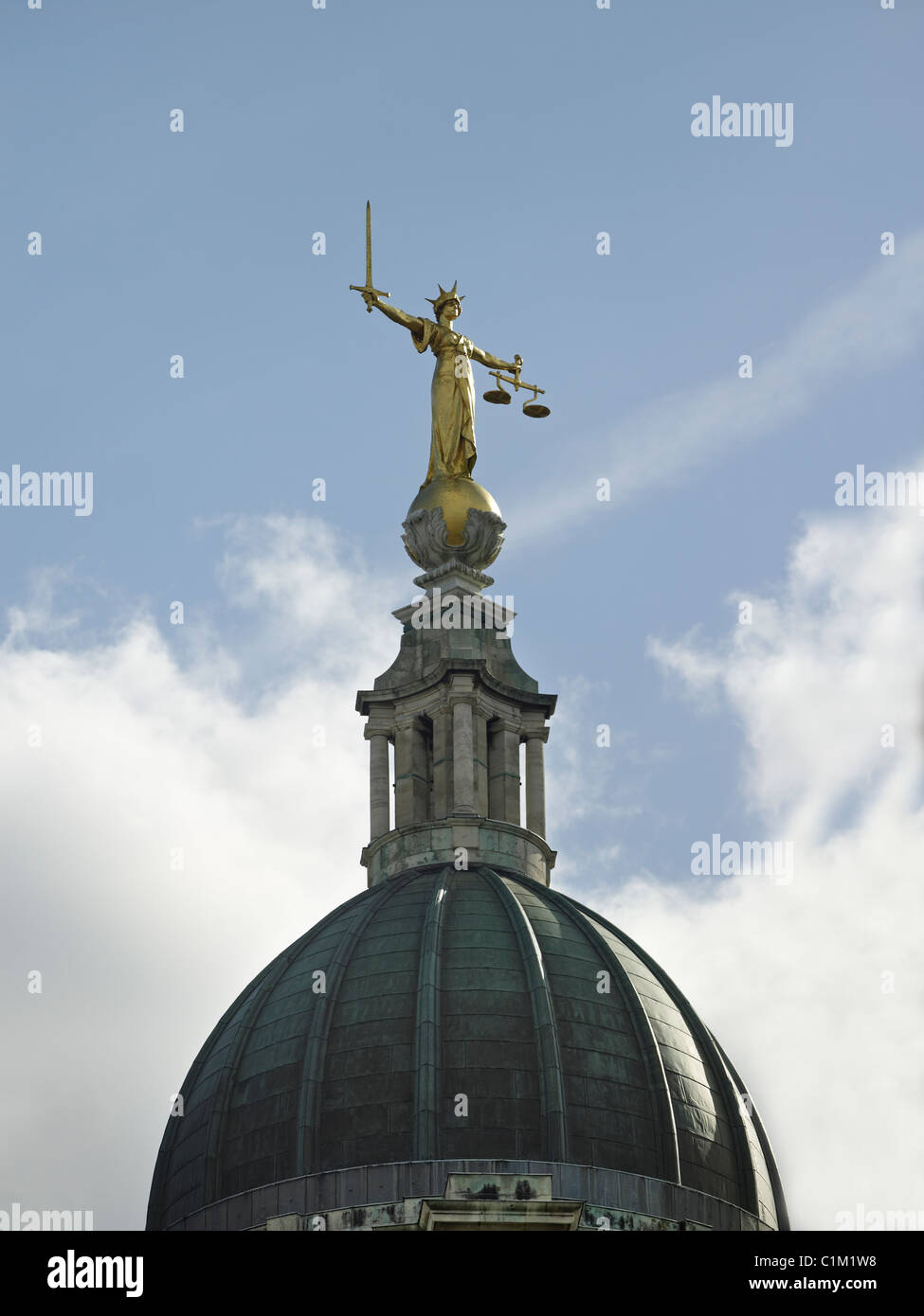 Figure of Lady Justice holding a sword for punishment and balance scales for justice, on the Old Bailey, The Central - Stock Image