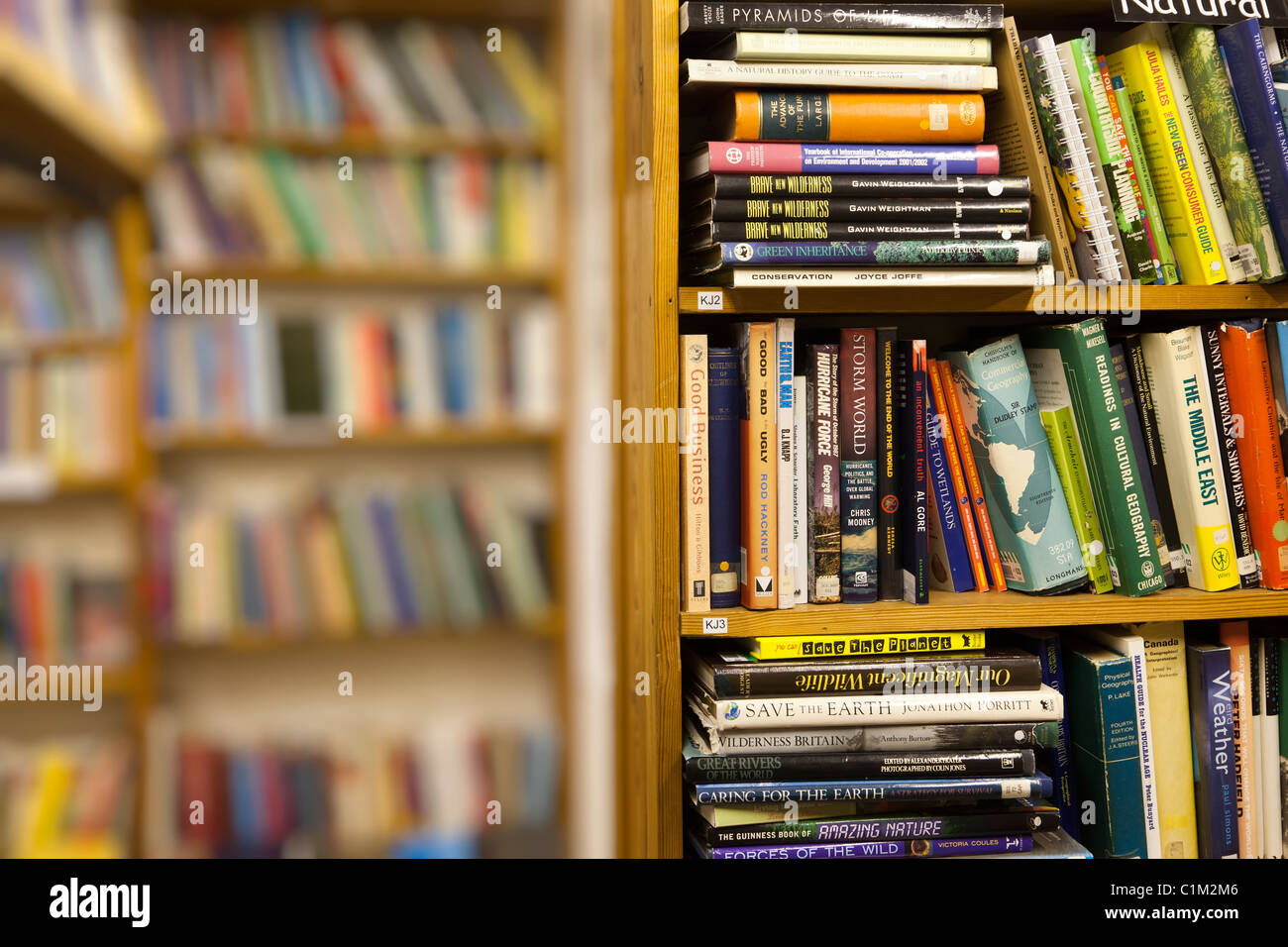 Hardback books on shelves in second hand bookshop Hay on Wye Wales UK - Stock Image