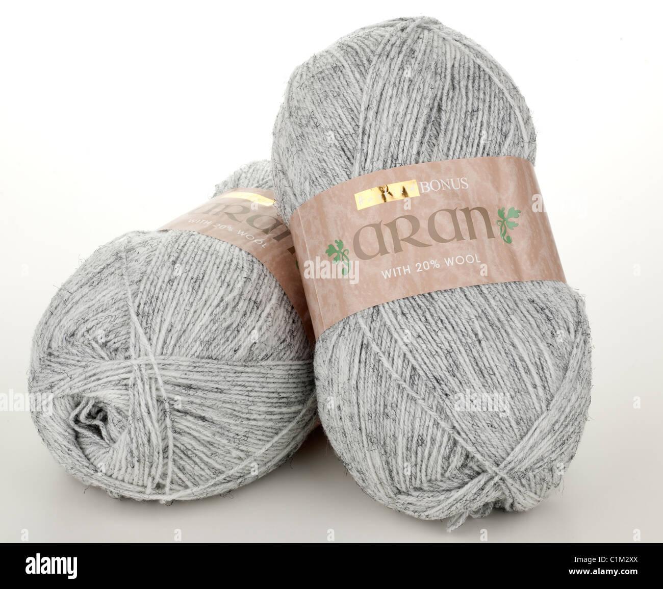 Two 400 gram balls of Hayfield Aran grey wool - Stock Image