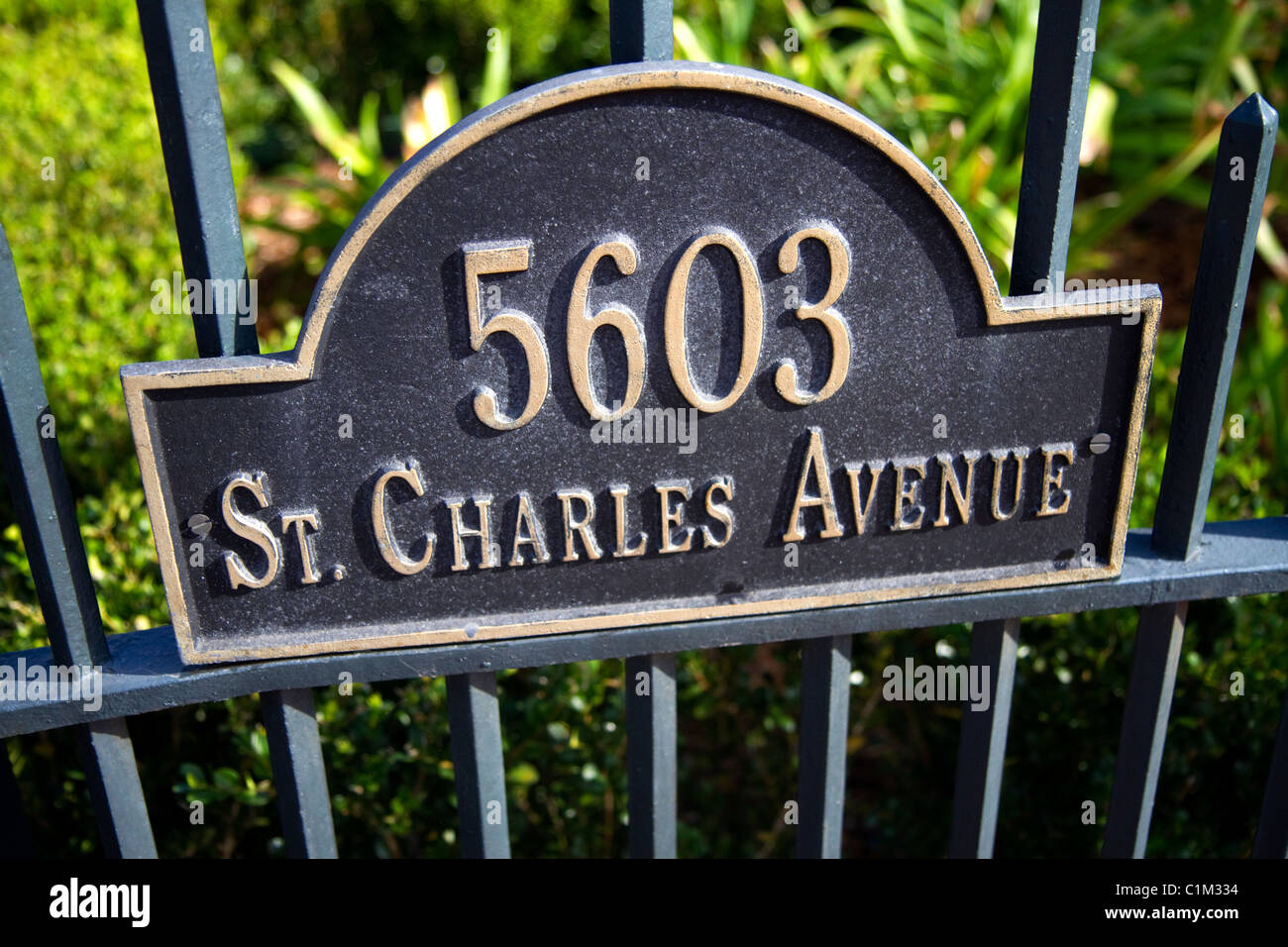 Address sign on the gate of the McCarthy House on Saint Charles Avenue in the Garden District of New Orleans, Louisiana, - Stock Image