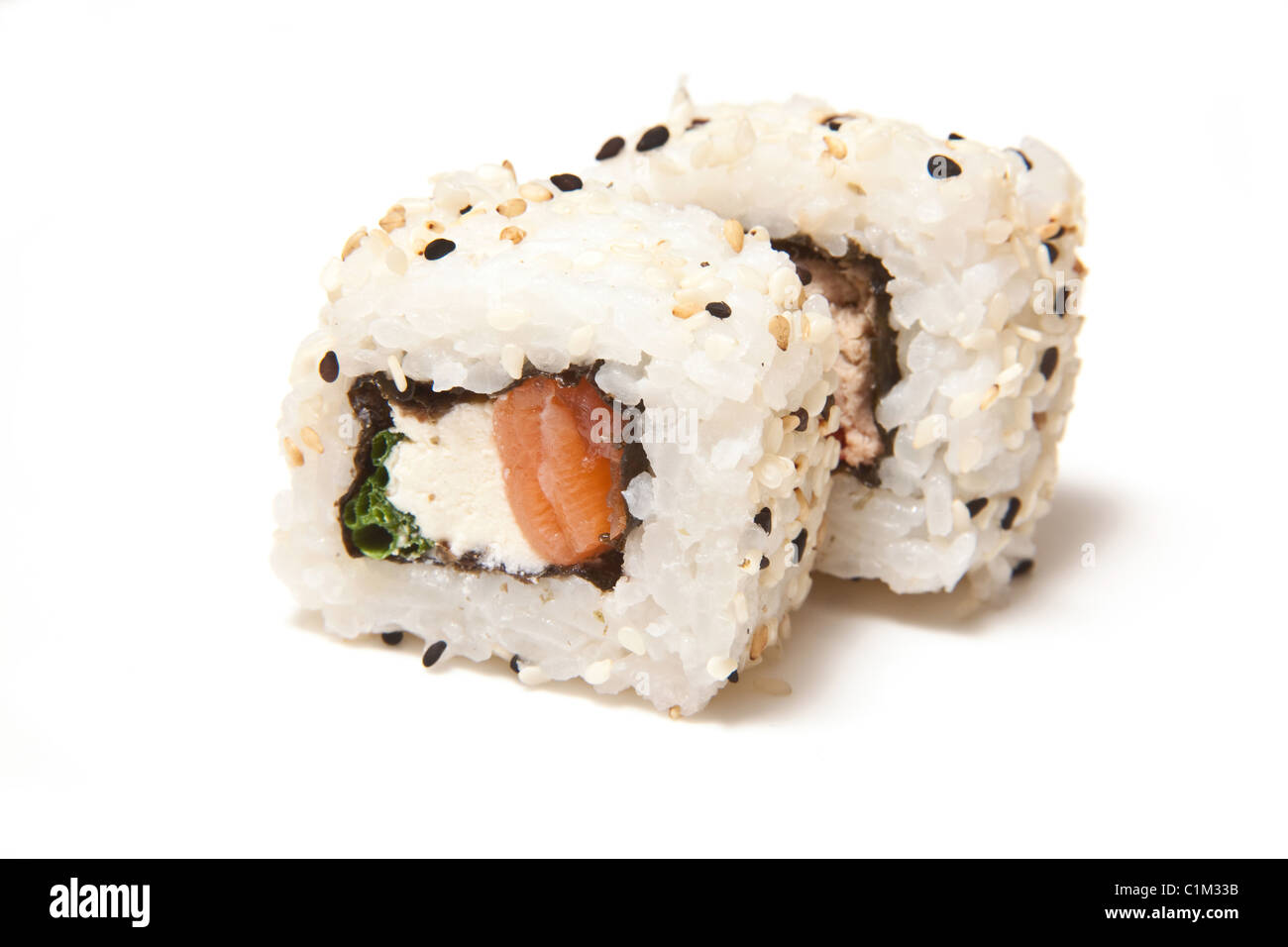 Salmon and cream cheese sushi roll isolated on a white studio background. - Stock Image