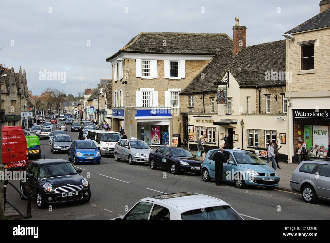 West Oxfordshire market town Witney showing busy traffic and congested parking. England UK - Stock Image