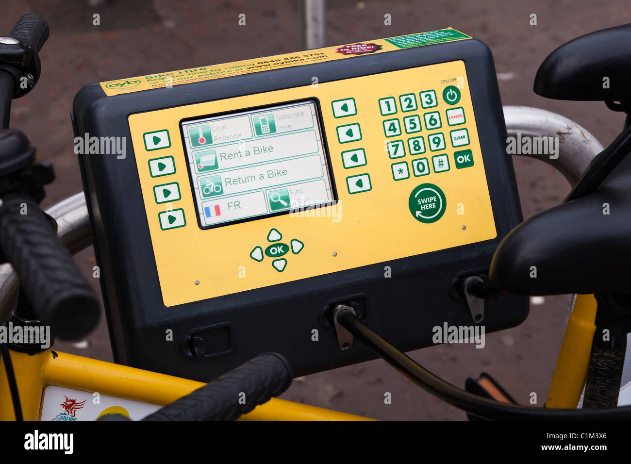 Meter on rent a bike stand Cardiff Wales UK - Stock Image