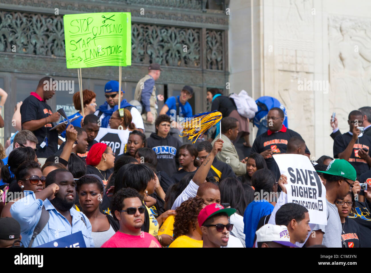 Demonstrators protest educational funding cuts on the steps of the state capitol building in Baton Rouge, Louisiana, - Stock Image