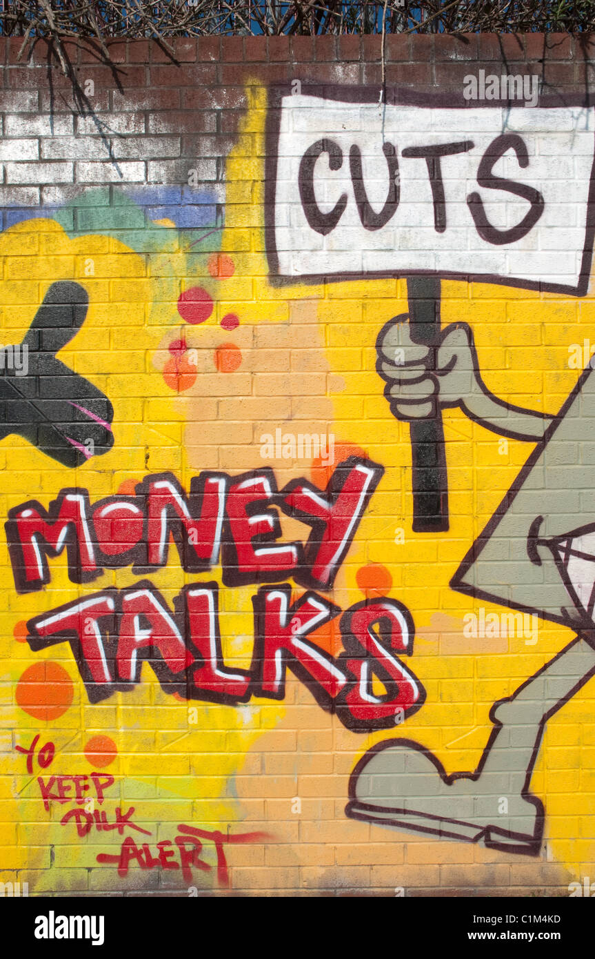 'Cuts'  'Money Talks' graffitti. - Stock Image
