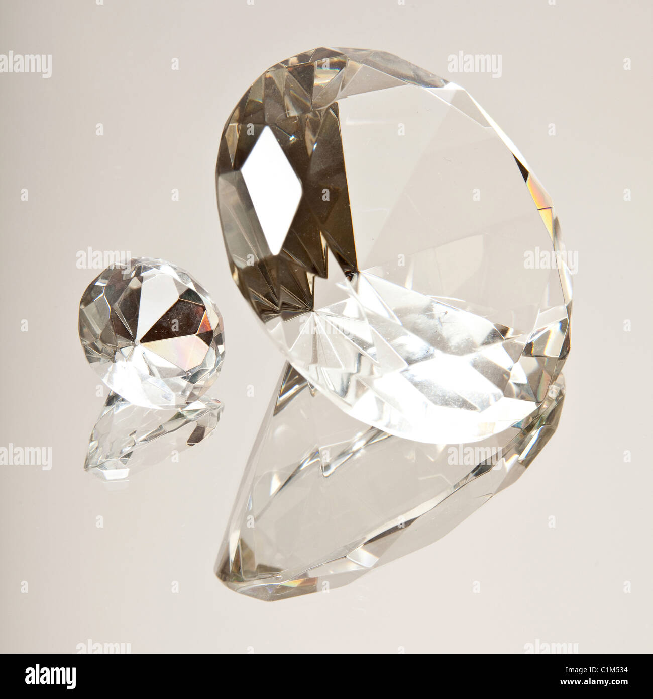Diamonds on a mirrored surface - Stock Image