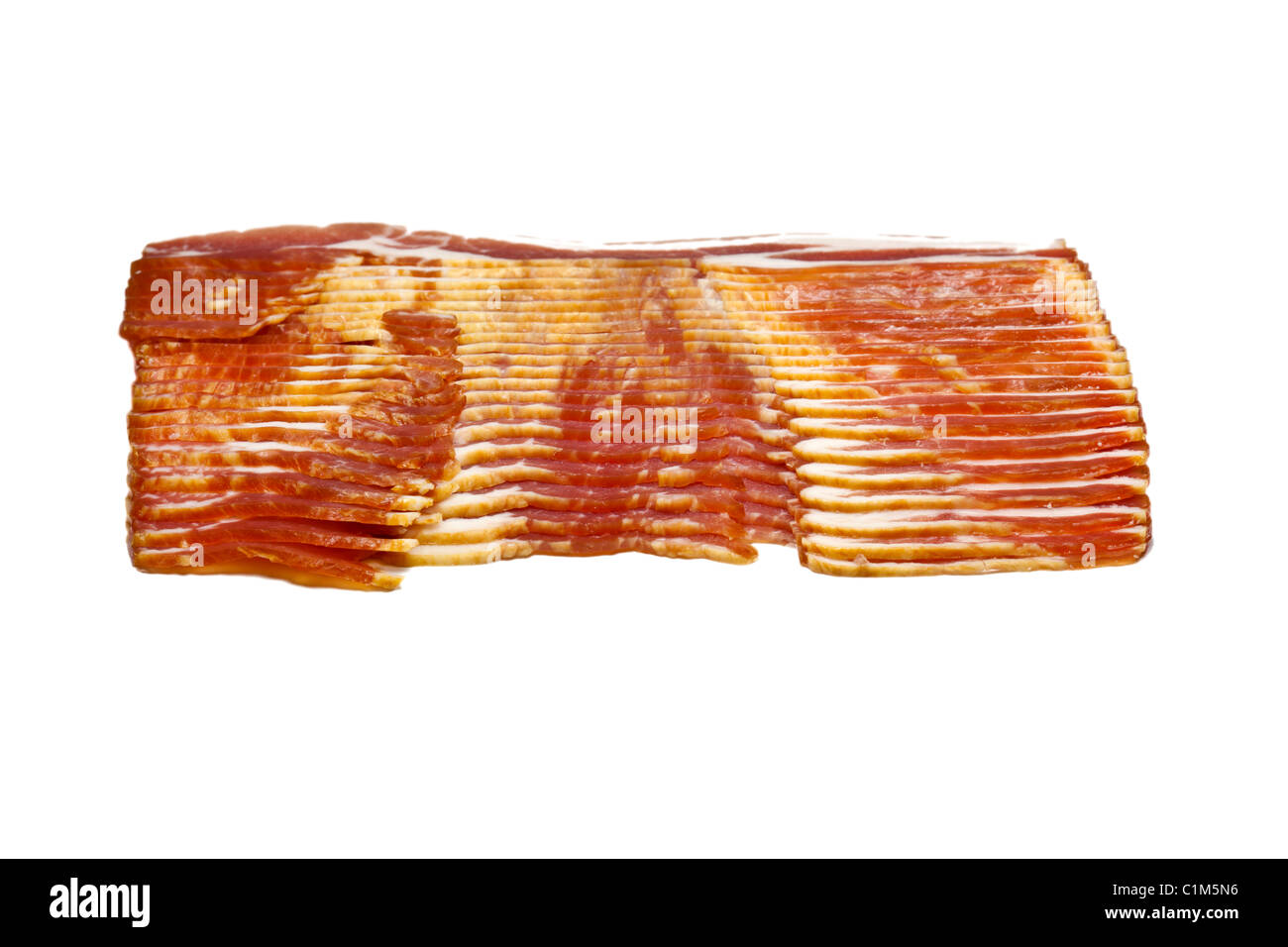 Uncooked stack of bacon isolated on white. Charles Lupica - Stock Image