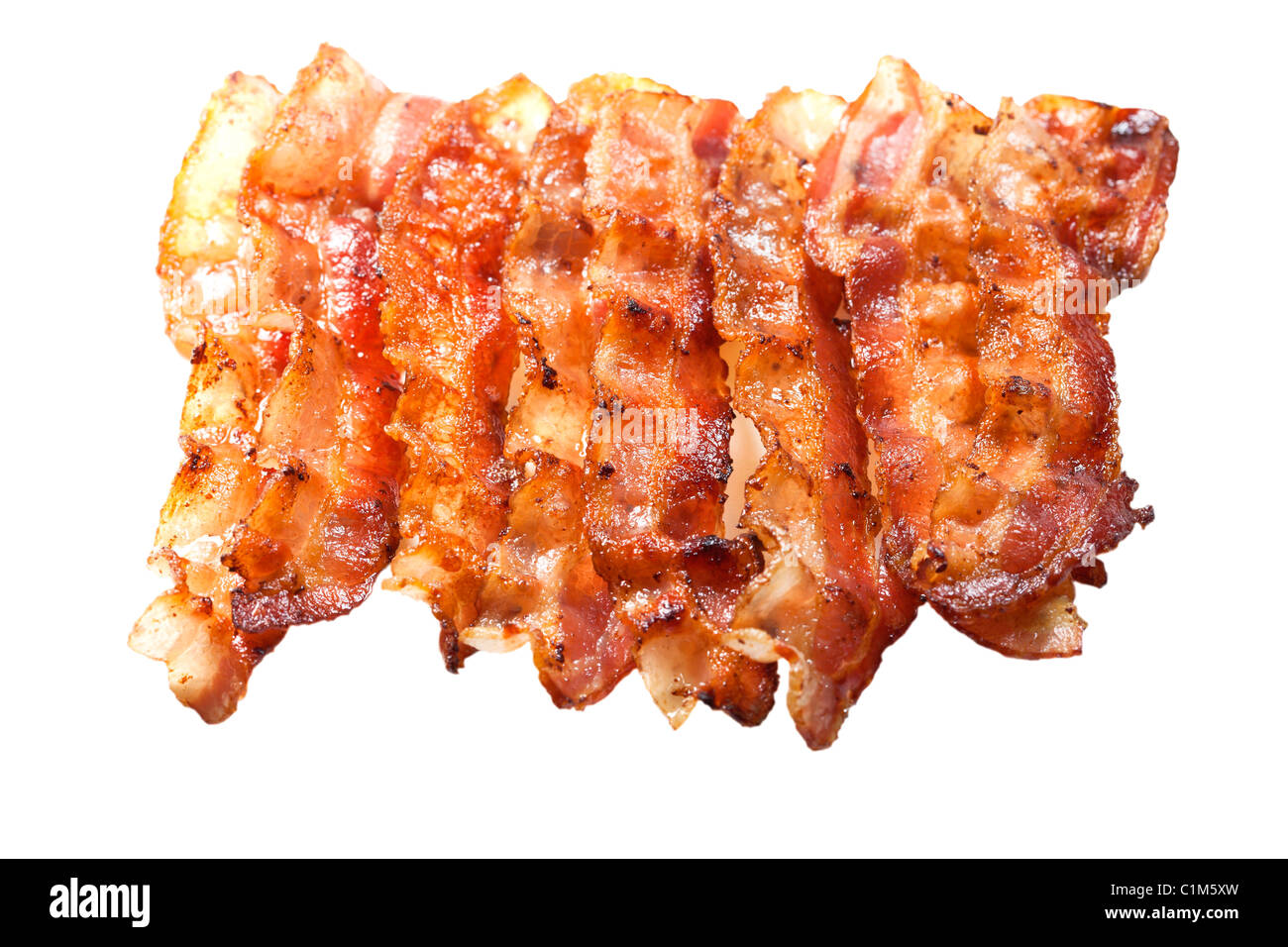 Cooked bacon isolated on white background. Charles Lupica - Stock Image