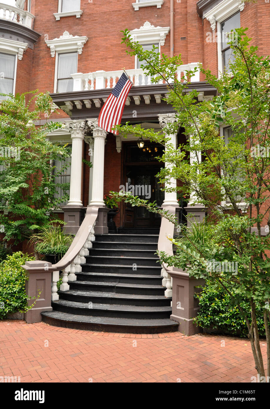 Exterior of an old red brick home with a staircase.  The home is in Savannah, Georgia. - Stock Image