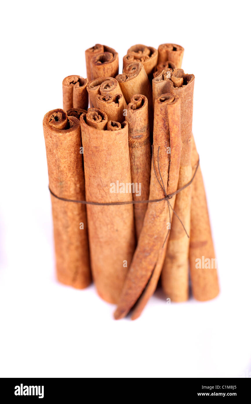 View of a bunch of cinnamon spice quills isolated on a white background. Stock Photo