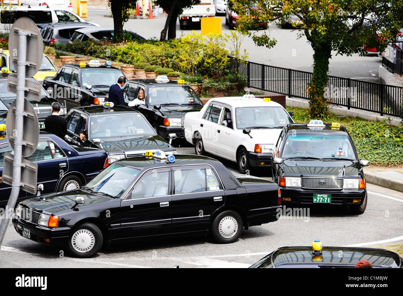 Taxis waiting for passengers in Kobe, Japan - Stock Image