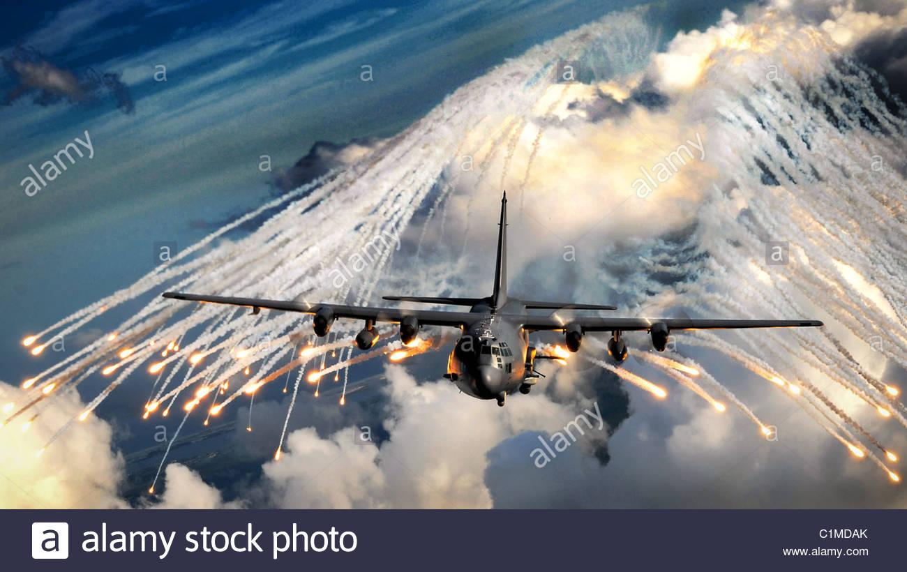 AC-130U gunship jettisons flares Aug. 20 over an area near Hurlburt Field, Fla. The flares are a countermeasure - Stock Image