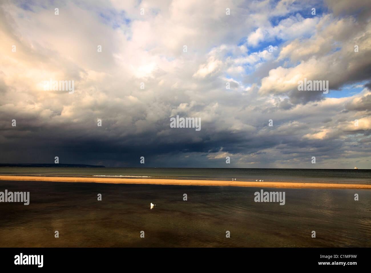 dramatic sky over the Baltic Sea - seen from beach in Binz on German Island Rügen - Stock Image