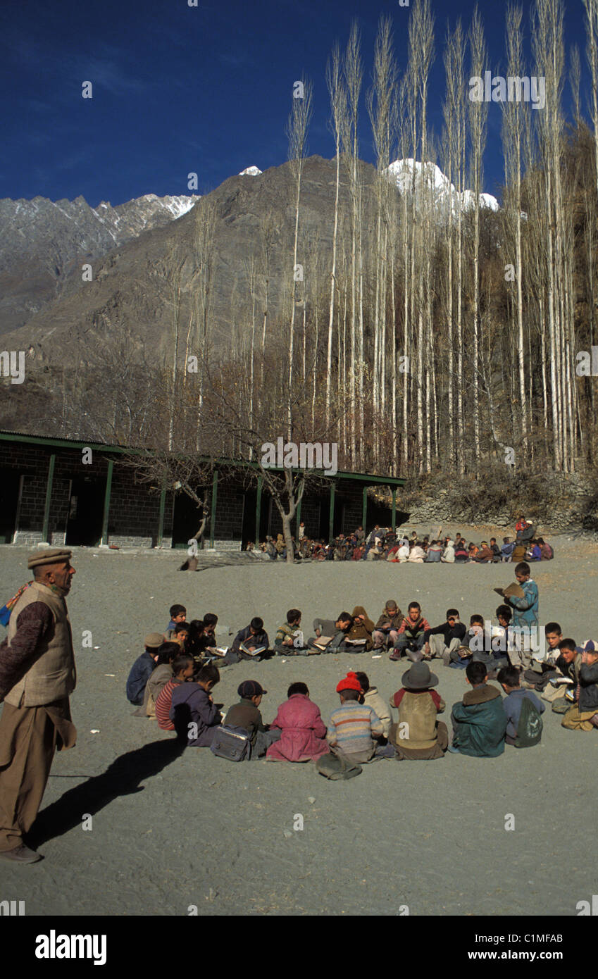Children sit in circle on ground in school yard in Altit in the Hunza region of Pakistan - Stock Image